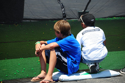 They were watching a paint ball battle just inside the tent.