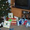 Christmas presents around the tree.