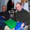 Stu opening a gift.