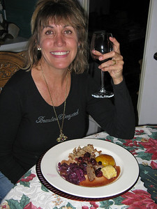Christmas Eve supper: tenderloin of wild boar with Sauce Grand Veneur, caramelized peach, walnut risotto, braised red cabbage with chestnuts, and a polenta dumpling.