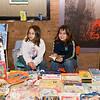 Selling children's books at Christmas Bazaar.