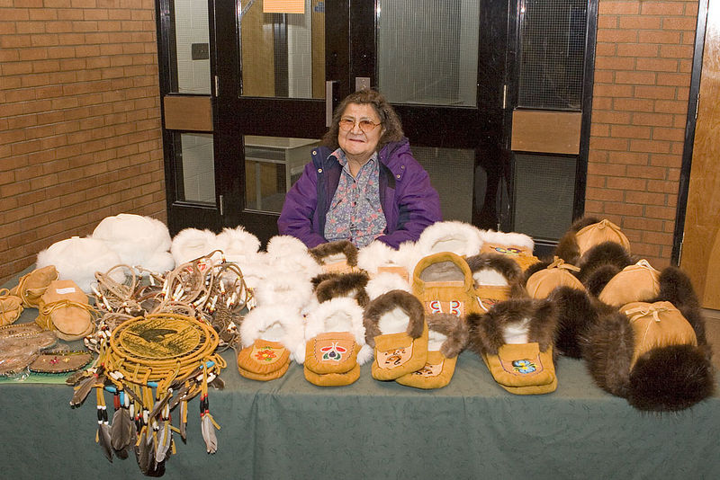 Ruby MacDonald of Moosonee selling crafts at Christmas Bazaar