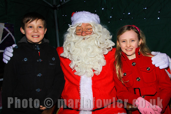 Charlie Brough age 10, Harwich Primary School and his sister Sophie age 8, All Saints' Primary School with Santa.