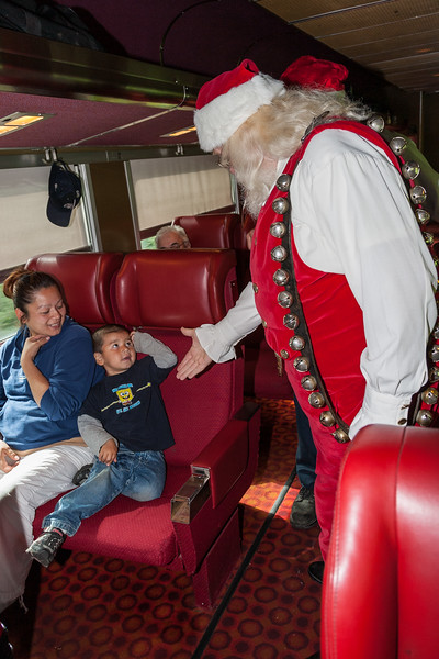 Santa Claus greeting a young passenger on the Polar Bear Express 2007 July 6