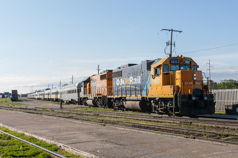 GP38-2s 1802 and 1805 bring the Polar Bear Express passenger consist, complete with two dome cars, towards the station platform in Cochrane 2007 July 6th.