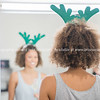 Young woman with green Chistmas theme headpiece