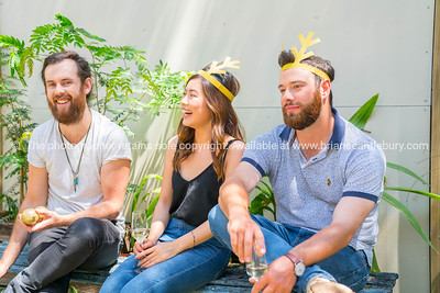 Three people sitting in garden enjoying one and others company