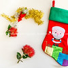 Child's santa stocking with rd pohutukawa flower and tinsel simple flat design.