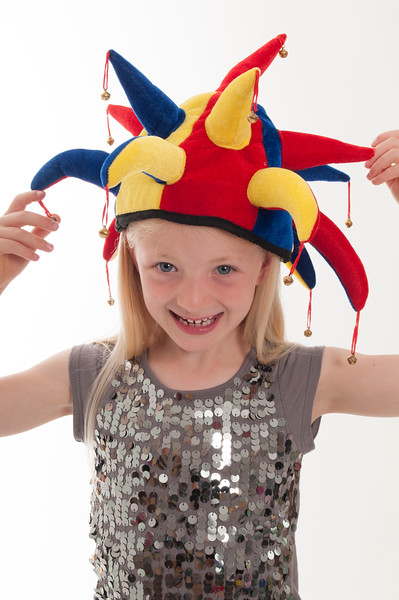 pretty blonde girl in a Christmas Jester hat isolated on White background