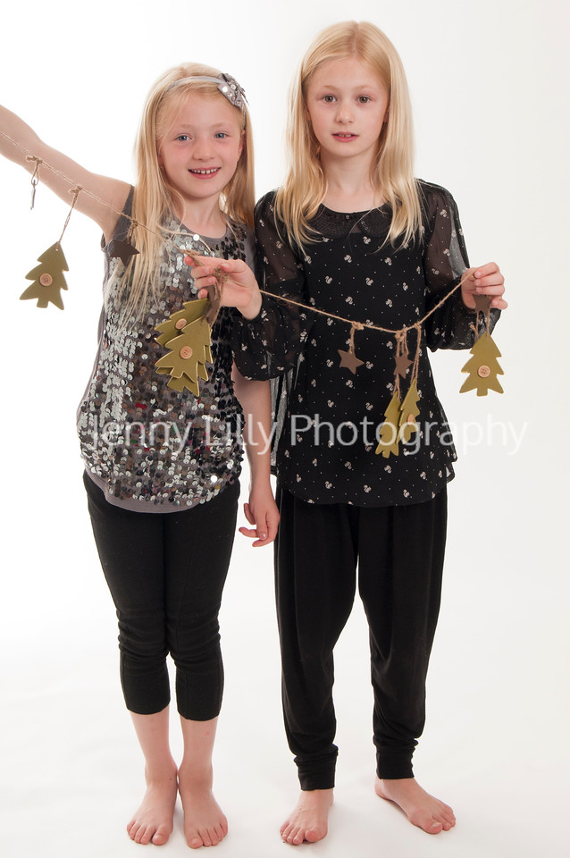 pretty blonde girls holding a Christmas decoration, isolated on white background