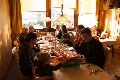 The baptism celebration lunch. Micha keeping Rémy behaved...