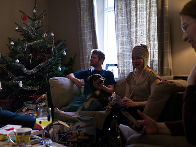 Loki helping Rory and Vicky open presents