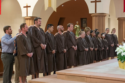 Catechumens, with their sponsors, awaiting baptism