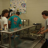 One of many chores. Trever and John's team serves while everyone else eats.