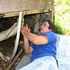 Matt under the trailer again fixing leaks.