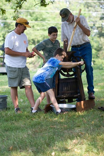 Mike, Jake, Sam, Dad grinding apples