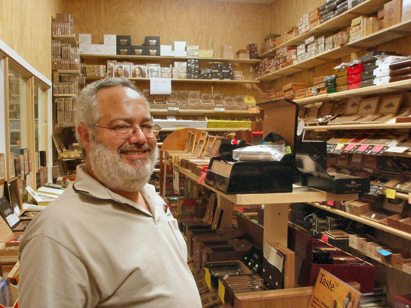Jim Luftman, owner and operator of Blue Havana II in his well stocked and organized humidor.