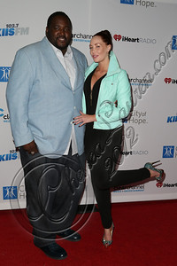 WEST HOLLYWOOD, CA - NOVEMBER 07:  Actor Quinton Aaron (L) and model Jenna Bentley attend the City of Hope's Fifth Annual MEI Comedy Roast Honoring Clear Channel's John Ivey at House of Blues Sunset Strip on November 7, 2012 in West Hollywood, California.  (Photo by Chelsea Lauren/WireImage)