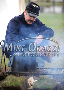 4/16/2011 Mike Orazzi | Staff Larry Cain cooks a ham over an open fire during the Civil War Commemoration and battle reenactment at Stanley Quarter Park in New Britain on Saturday.