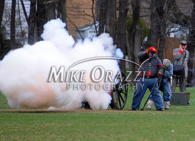4/16/2011 Mike Orazzi | Staff Members of Confederate army fire their canons at the Civil War battle reenactment at Stanley Quarter Park in New Britain on Saturday as part of the Civil War's 150 year commemoration.