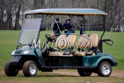 4/16/2011 Mike Orazzi | Staff Members of the Union Army framed by a golf car at their Civil War battle reenactment at Stanley Quarter Park in New Britain on Saturday.