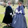 Record-Eagle/Loraine Anderson<br /> Chelsea Howard (left) and Jerie Leyh of Boyne City dressed in Civil War-era fashion for the grave dedication and memorial service for two Civil War soldiers buried in Maple Lawn Cemetery.