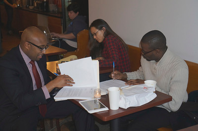 Ivan Learmont '01 and Kehinde Togun '02 at a cafe in DC.