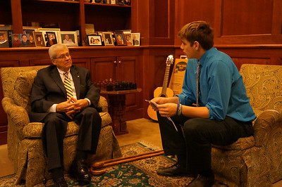 Benedict News reporter Bobby Edwards '14 interviews Bill Mealia '56 for a story on the day.