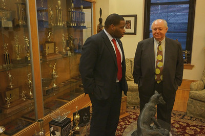 Roosevelt Donat '03 and Peter Ryan '61 chat in the Trophy Room before Convocation.