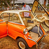 Its a BMW mini cooper Isetta Italian Style with a front door!