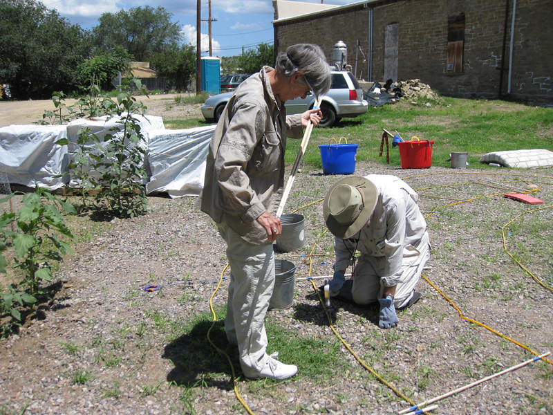 Bert & Patty measuring path and staking down rope.