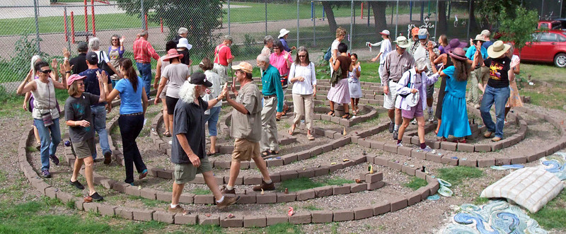 Guests doing celebratory High Fives walking out of Adobe Labyrinth and over the Threshold.