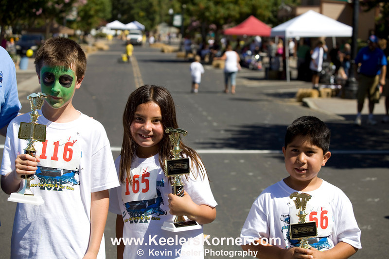L to R. Winners in Age group 7-8. 1st Place Max Faerber, 2nd Place Samantha Romero, 3rd Place Tom Sanchez.