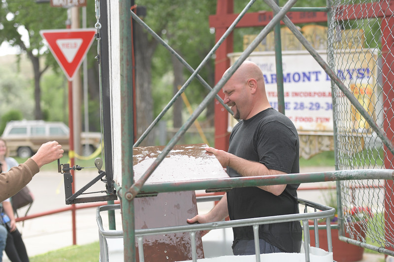 Ryan Patterson | The Sheridan Press<br /> Sheridan County Sheriff Allen Thompson sets up the dunk tank during Clearmont Days Saturday, June 29, 2019.