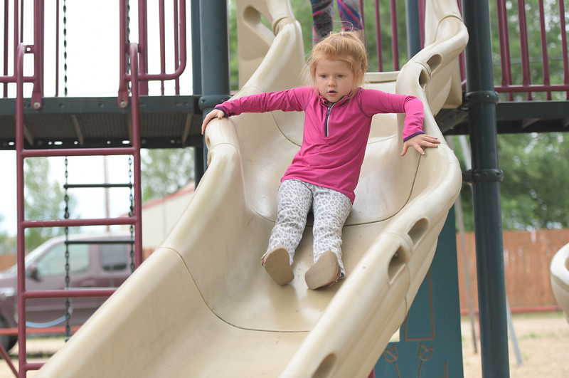 Ryan Patterson | The Sheridan Press<br /> Teegan Olson, age 4, goes down a slide during Clearmont Days Saturday, June 29, 2019.