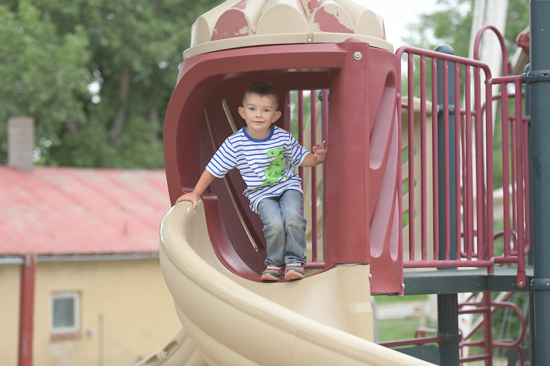 Ryan Patterson | The Sheridan Press<br /> Grady Betz, age 3, prepares to go down a slide during Clearmont Days Saturday, June 29, 2019.