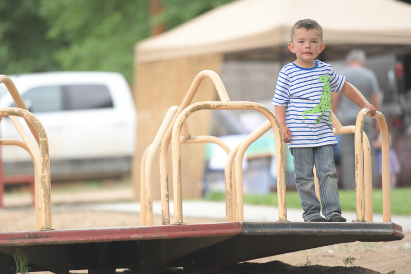 Ryan Patterson | The Sheridan Press<br /> Grady Betz, age 3, rides on a merry-go-round during Clearmont Days Saturday, June 29, 2019.
