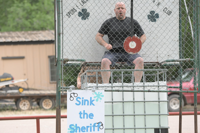 Ryan Patterson | The Sheridan Press<br /> Sheridan County Sheriff Allen Thompson sits in a dunk tank during Clearmont Days Saturday, June 29, 2019.