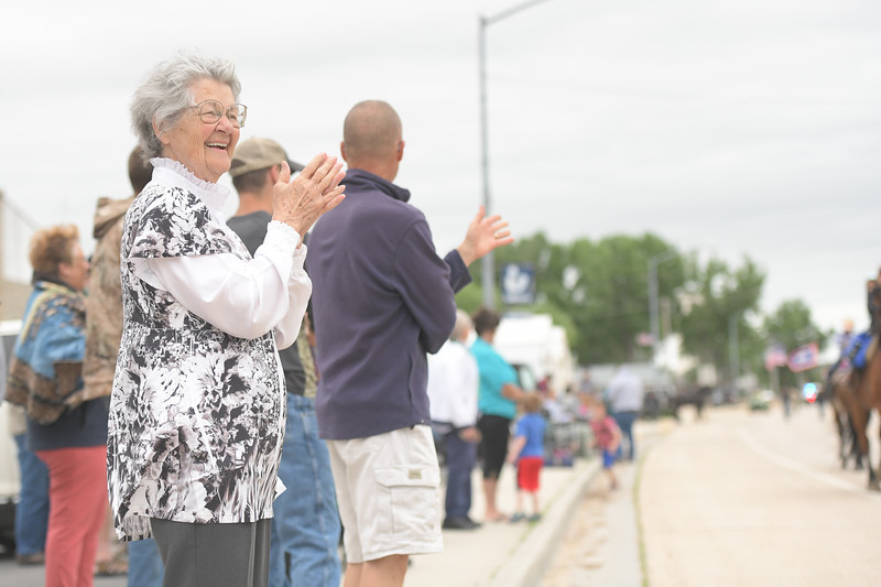 Ryan Patterson | The Sheridan Press<br /> Terrill Foster, left, enjoys the parade during Clearmont Days Saturday, June 29, 2019. Foster is the chairperson of the Clearmont Historical Center.