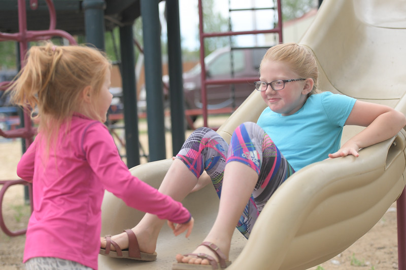 Ryan Patterson | The Sheridan Press<br /> Teegan Olson, left, plays with Rylee Olson during Clearmont Days Saturday, June 29, 2019.