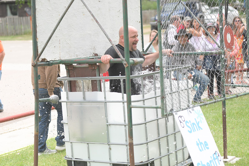Ryan Patterson | The Sheridan Press<br /> Sheridan County Sheriff Allen Thompson falls into a dunk tank during Clearmont Days Saturday, June 29, 2019.