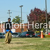Jason Zambrano, Devonte McGee and Bayden Miller hop their way across the grassy area next to the Clinton Public Library during a sack race on Saturday at the September Showcase. • Katie Dahlstrom/Clinton Herald