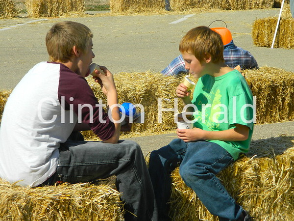 Austin and Cameron Kersey enjoy the ice cream that was available at the September Showcase on Saturday at the Clinton Public Library's main branch. • Katie Dahlstrom/Clinton Herald