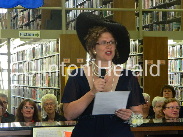 Library Director Amy Birtell, dressed as Lillian Russell, makes a speech during the dedication of the new circulation desk. The desk was dedicated to David O. Shaff during the September Showcase on Saturday at the Clinton Library's main branch. • Katie Dahlstrom/Clinton Herald