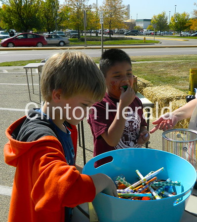 Bayden Miller and Jason Zambrano pick out prizes at the September Showcase on Saturday at the Clinton Public Library's main branch. Kids earned prizes by playing a number of games at the event.  • Katie Dahlstrom/Clinton Herald