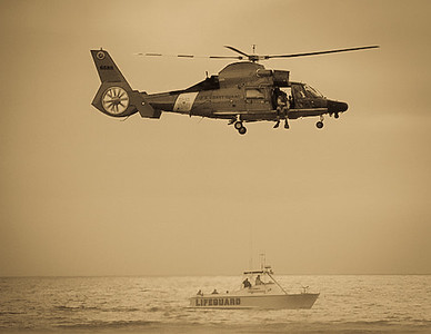 Coast Guard helicopter demonstrating rescue techniques with L.A. County Lifeguards.
