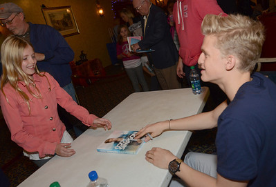 """Erica Benson-ebenson@shawmedia.com Cody Simpson fans including Abby Schmidt of Palos Hills experience a performance followed by a book signing for his book """"Welcome to Paradise: My Journey"""" at the Tivoli Theatre Tuesday October 22 2013."""