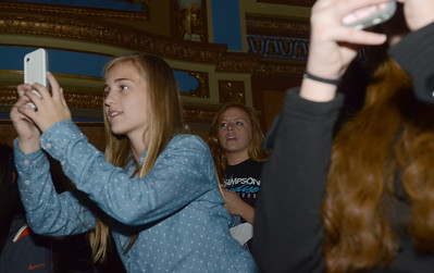 """Erica Benson-ebenson@shawmedia.com Cody Simpson fans including Caitlin Chval of Clarendon Hills take photos on their cell phones during his performance at the Tivoli Theatre Tuesday October 22 2013.  The night included a book signing for his book """"Welcome to Paradise: My Journey"""""""