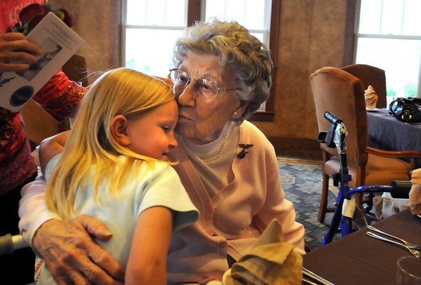 Josephine Kater Robinson, 92, a WWII WASP, Women Airforce Service Pilots, gives her great grand daughter Claire Wisenborn, 6, a kiss after Robinson was given the Congressional Gold Medal dat The Stratford at the Flatirons on Saturday.<br /> May 22, 2010<br /> Staff photo/ David R. Jennings