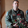 1st Lt. Carson Brusch holds flowers to be given to Josephine Kater Robinson, 92, a WWII WASP, Women Airforce Service Pilots, during Robinson's Congressional Gold Medal ceremony at The Stratford at the Flatirons on Saturday.<br /> May 22, 2010<br /> Staff photo/ David R. Jennings